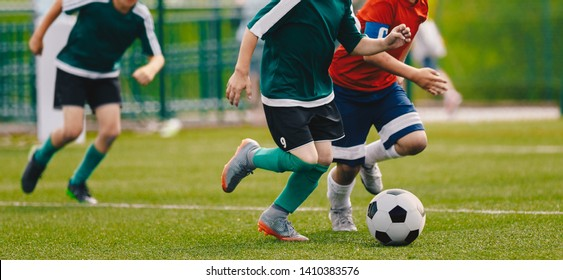 Children Play Football Tournament Game. Young Boys Running and Kicking Football Ball on Grass Sports Field