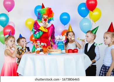 Children play and have fun with a clown at a birthday party.