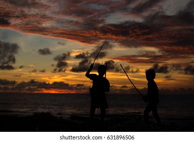 Children play and have fun at sunset by the sea. Childhood, game, sunset, sea.