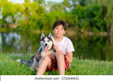 children play with husky puppy