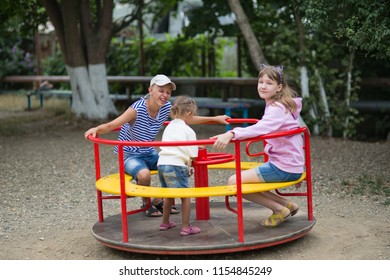 Children play in the playground, swing on the swing