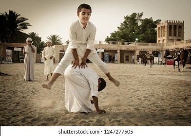 Children play popular games of Gulf heritage Doha, Qatar may 2014