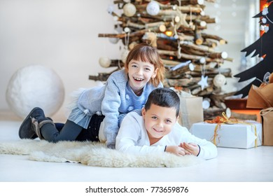 Children play in the room. Brother and sister. Concept Happy Christmas, New Year, holiday, winter, childhood.