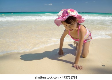 Children play in the sand at the beach. The sea and the beautiful nature.Family photo. Happy family. Young Asian model.landscape.Beautiful beaches in the summer of Thailand.