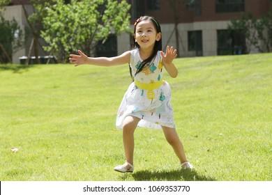 Children play sand outdoors