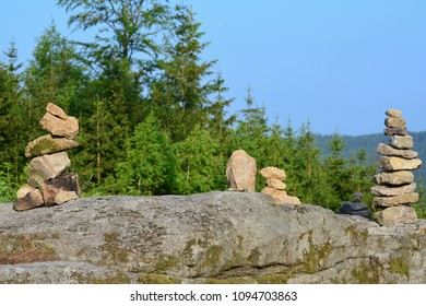 Children play with a stone, South Bohemia, Czech Republic