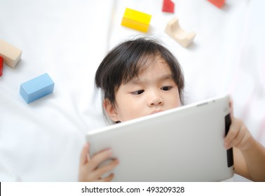 Children play Tablet on white background