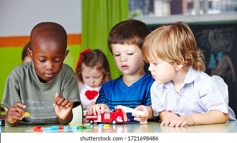 Children play together with a fire brigade in kindergarten