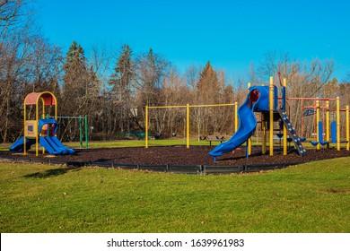 children playground activities in public park without children . Colorful Safe modern children`s playground.