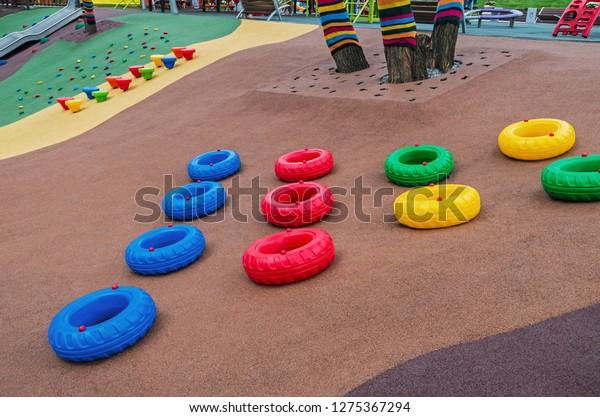 children-playground-multicolored-tires-m