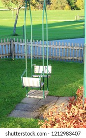 Children playground with swing, wooden chairs, in autumnal landscape, Bavaria