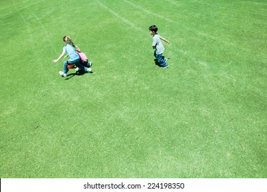 Children playing ball on grass