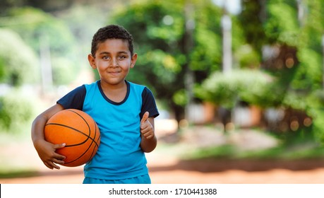 Children playing with basketball in the street during quarantine against the coronavirus pandemic (COVID-19), in Glória de Dourados, Mato Grosso do Sul, Brazil.