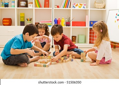 Children playing with blocks on the floor