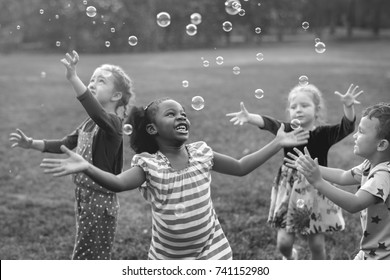 Children playing bubbles in a park