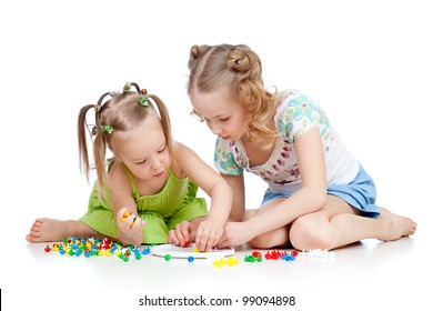 children playing with color toy over white background