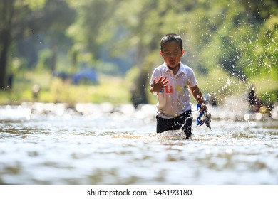 Children playing in the creek water.