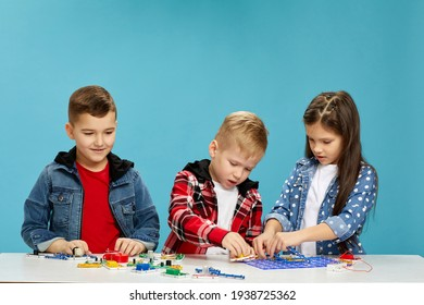 children playing with electronic constructor at studio