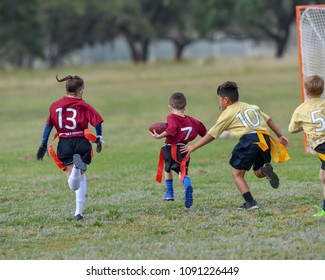 Children playing a Flag Football game outside