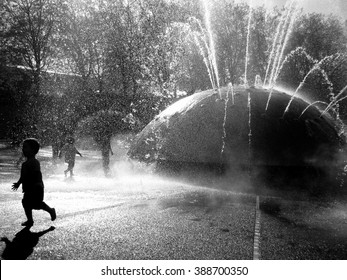Children playing in a fountain in Seattle, WA.