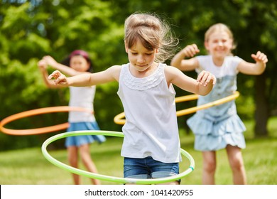 Children playing with hoops in the park