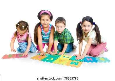 children are playing letters ; isolated on the white background