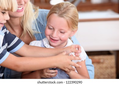 Children playing with mother