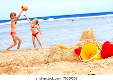 Children  playing on  beach with ball.