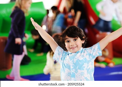 Children playing on colorful kindergarten playground