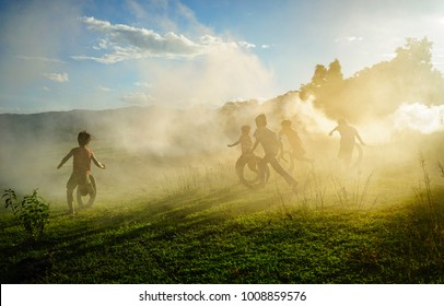 Children playing on dusty grass field at countryside in Central Highlands of Vietnam.