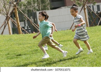 Children are playing on the grass