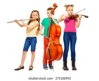 Children playing on musical instruments together