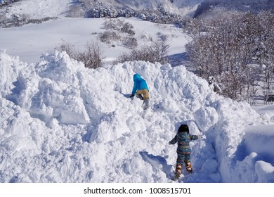 Children playing on a snowy mountain
