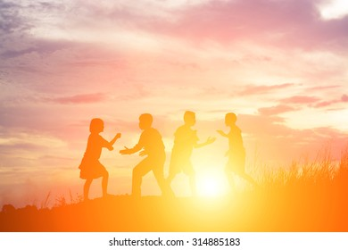 Children playing on summer sunset happy time