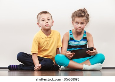 Children playing on tablet. Having fun and learning