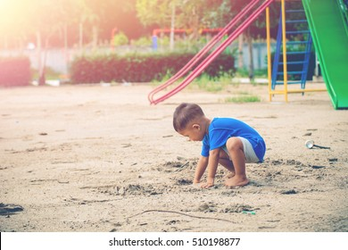 Children playing park. Little baby playing in the park on the  on a sunny day with sunrise.