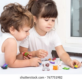 Children playing with plasticine. Development toys for preschooler kids