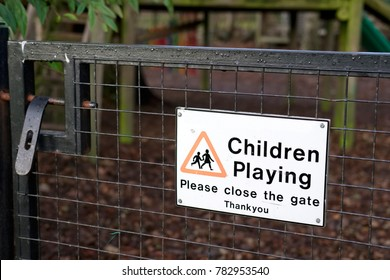 Children Playing Please Close Gate Sign at Playground
