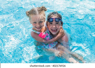 Children playing in the pool fun and enjoy