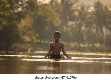 Children playing in the river at rural .