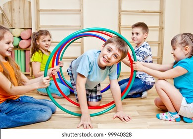 Children playing in school gym