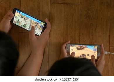 The children are playing smartphone shooting game in Asia. PLAYERUNKNOWN'S BATTLEGROUNDS, PUBG. (Seoul, Korea. Sept. 22, 2018)