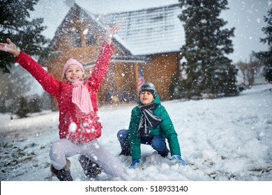 children playing with snow and having fun outdoor