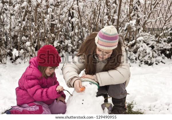 children playing in snow,soft focus