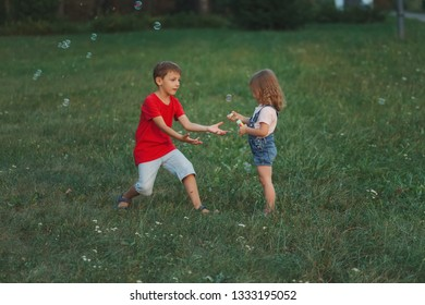 children playing with soap bubbles in park