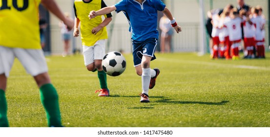 Children Playing Soccer Game During Primary School Soccer Tournament