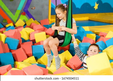 Children playing with soft cubes in the dry pool in play center. playground with foam blocks in trampoline club
