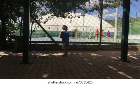 Children are playing tennis.
