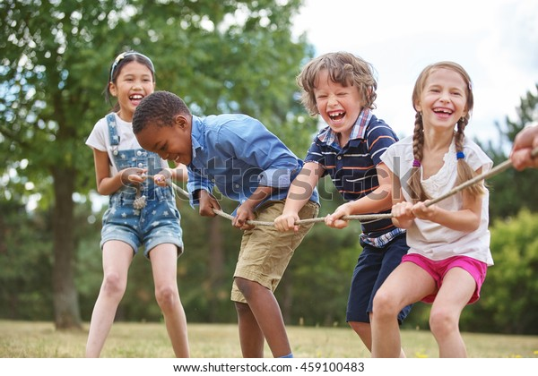 Children playing tug of war at the park