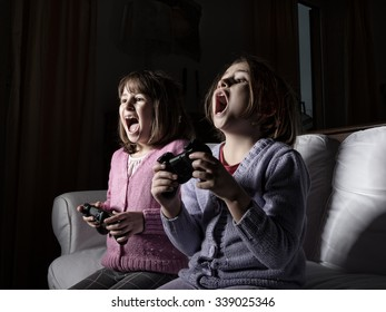 children playing with videogames, living room area